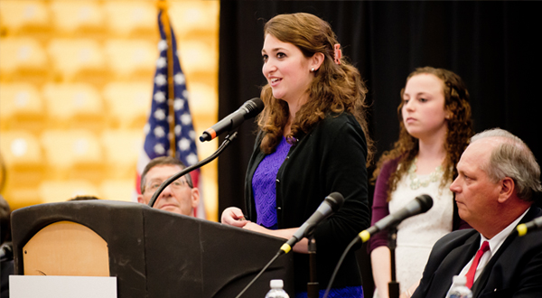 Woman speaks at REIG event