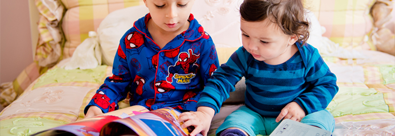 Young boys read books from PJ Library
