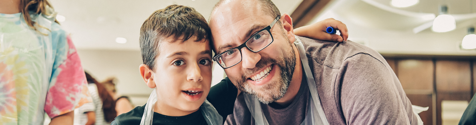 Man and son volunteering together