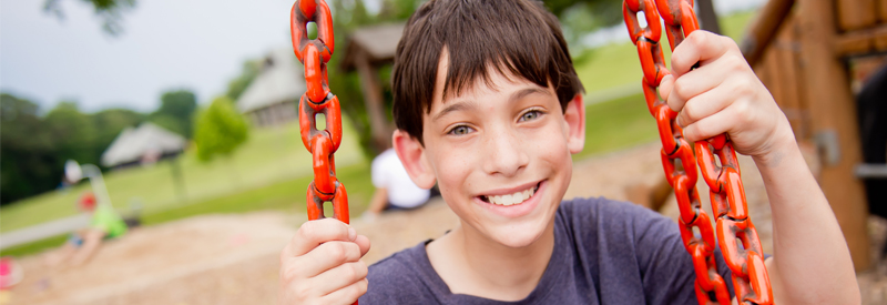 Boy on the swing at Jewish camp