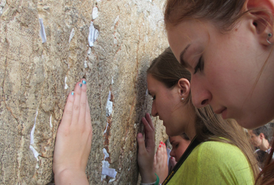 Teens standing at wall in Israel
